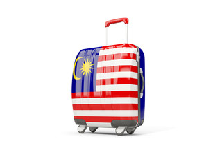 Luggage with flag of malaysia. Suitcase isolated on white