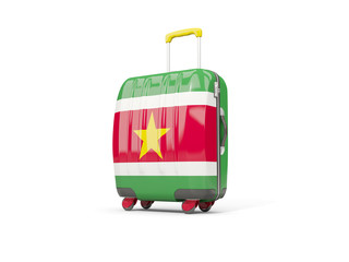 Luggage with flag of suriname. Suitcase isolated on white
