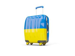 Luggage with flag of ukraine. Suitcase isolated on white