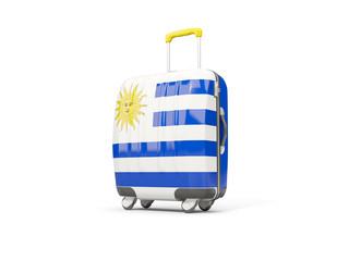 Luggage with flag of uruguay. Suitcase isolated on white
