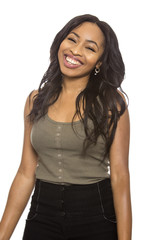 Black female isolated on a white background displaying happy facial expressions.  She is young and of African American ethnicity.