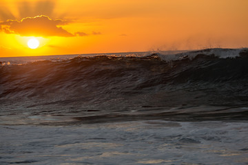 Sunset ocean wave rising