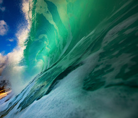 Water in Big green ocean surfing wave barrel