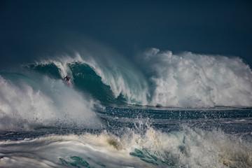 Extremal surfing at Northshore, Oahu, Hawaii. Big ocean waves crashing.