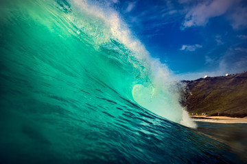 Big ocean green wave. Water surface in barrel surfing shape.
