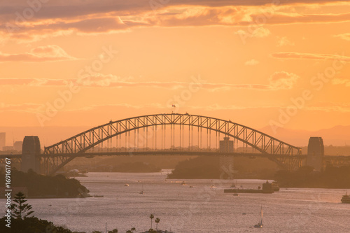 Sydney Harbour Bridge view in warm sunset time.