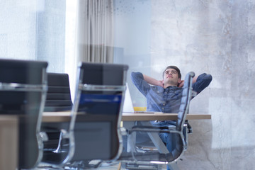 young businessman relaxing at the desk