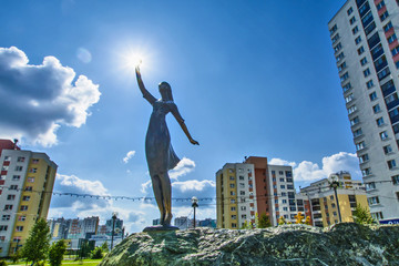 Russia . Ekaterinburg . Sculpture girl on the background of the urban landscape