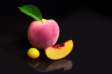 Peaches on Black Shiny Background