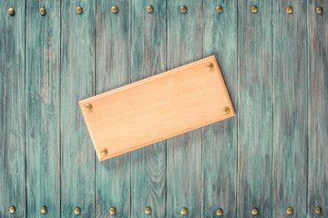 Sign board blank on vintage old grunge wooden wall planks texture background. Retro style filtered photo