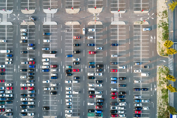 Cars in a parking lot seen from above