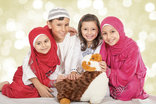 Happy little Muslim kids playing with sheep toy - celebrating Eid ul Adha - Happy Sacrifice Feast