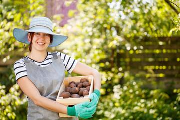 Young brunette farmer in hat