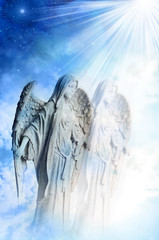 Angel archangel Gabriel over blue sky with divine rays of light