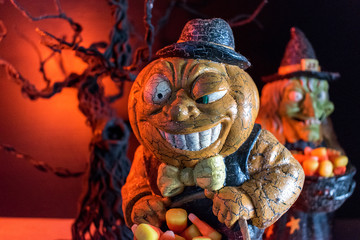 Halloween characters in spooky background collecting candy corn closeup
