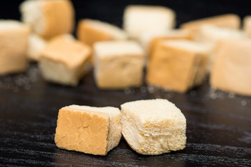 close up of crouton on black background, the crispy bread in cubic shape for ingredient or side dish