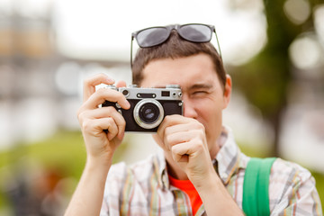 Photo of man with camera