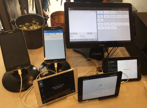 Electronic devices for managing delivery orders are shown at the food counter at Presidio Pizza Company in San Francisco