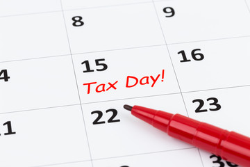 Tax day on calendar with red marker pen