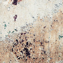 Old peeling paint texture with cracks and rust spots. Grunge background.
