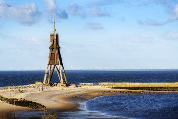 Kugelbake, old sea sign and landmark against the blue sky, symbol of the town Cuxhaven on the North Sea in Germany, copy space