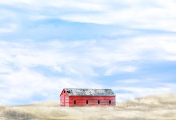 Barn on hill in cloudy field