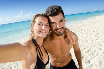 couple of lovers taking selfie photo at the beach