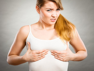 Woman suffering from breast pain