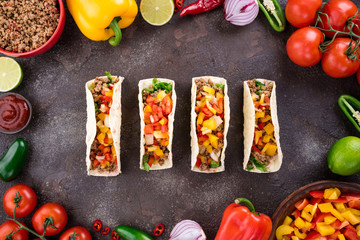 Mexican tacos with vegetables and meat. Ingredient for cooking tacos al pastor on concrete background. Top view