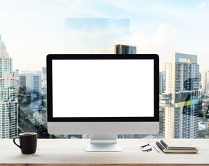 desktop computer white frame on work table in office place city background