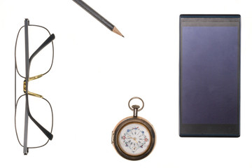 Vintage pocket watch, glasses, pencil,  mobile phone isolated on white background.