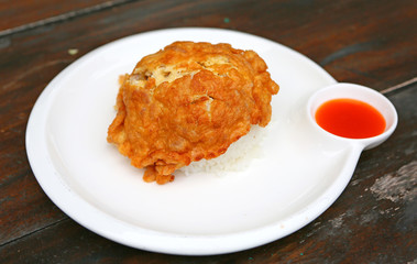 Mince pork omelet with rice and sweet sauce thai style, Popular local food in Thailand.