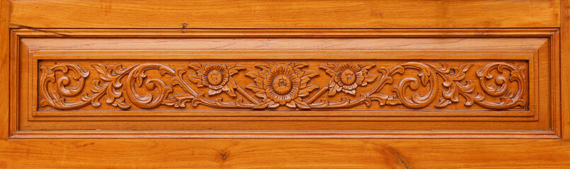 Pattern of flower carved on wood background, Thai style.