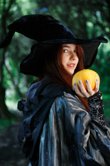 Image of witch with pumpkin in hand