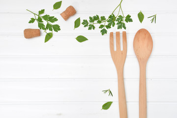 Cooking background with wooden fork and spoon from top view