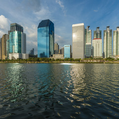 Cityscape view of buildings with Blue sky, clouds background at Benjakitti Park, Bangkok, Thailand