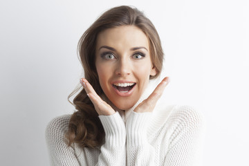 Surprised woman in sweater
