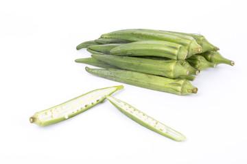 Closeup of okra on a white background.
