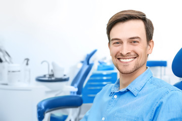 Male patient at dentist's office in clinic