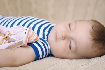 Cute little baby sleeping on bed