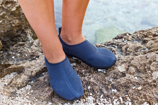 Female feet with water shoes in Croatia