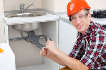 plumber at the kitchen