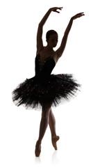 Ballerina silhouette making ballet position arabesque against white background