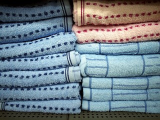 Colorful towels stacked on a shelf
