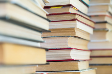 A stack of books with colorful covers. The library or bookstore. Books or textbooks. Education and reading.