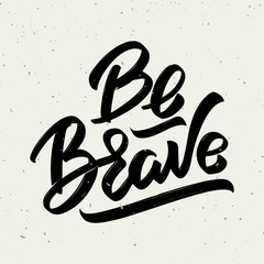 Be brave. Hand drawn lettering phrase isolated on white background.
