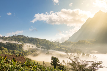 Doi Luang Chiang Dao mountain with sunrise and fog in the morning, Chiang Mai Province, Thailand