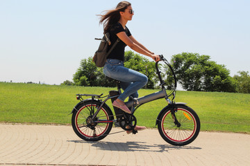 A women riding on electric e bike in the park