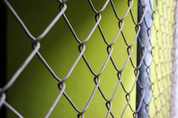 Close up metal chain-link fence pattern background.