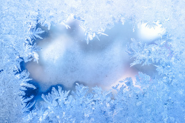 fairy winter ice, blue texture on window, holiday background, close up